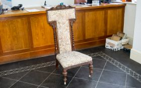 A Late 19th Early 20th Century Nursing Chair High back with low seat and carved detail to legs and