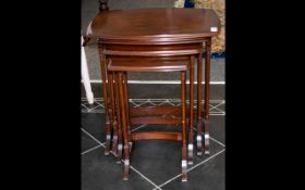 Mahogany Style Reproduction Nest of Tables of typical form,
