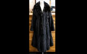 Full Length Dark Brown Mink Coat fully lined in poly satin with patterned lining.