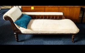 Chaise Longue Of large proportions with carved headrest and spindle back, raised on turned legs with