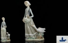 Lladro Porcelain Figurine ' Girl with Go