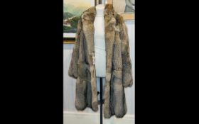 Contemporary Oversized Genuine Wolf Fur Coat Unisex coat - a bespoke/sample piece in plush silver