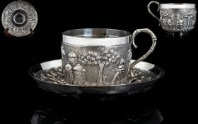 Late 19thC Oriental Handmade Embossed Silver Cup and Saucer decorated with embossed images of