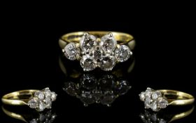 18ct Gold Pleasing 7 Stone Diamond Cluster Dress Ring of good colour and sparkle to all diamonds.
