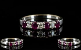 18ct White Gold - Attractive Ruby and Diamond Dress Ring, The Four Rubies Interspaced with Diamonds,