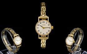 Swiss Mondia Ladies Mechanical Wind 9ct Gold Bracelet Watch with attached 9ct gold bar bracelet and