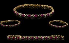14ct Gold Ladies Ruby and Diamond Set Bracelet with X Design.
