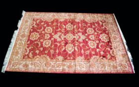 A Very Large Woven Silk Carpet Large Zeigler carpet, red ground with repeated red floral and foliate