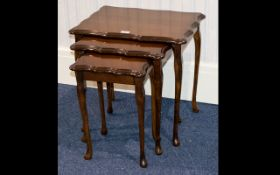 A Nest of Tables mahogany table of shaped form with long cabriole legs.