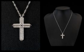 18ct White Gold Diamond Cross Set With 40 Brilliant Diamonds. Good Colour and Clarity.