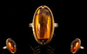 Russian Nice Quality and Attractive Cabochon Cut Amber Set Ring. Set in 14ct Gold.