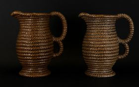 A Pair Of Govancroft Rope Design Two Handled Pitchers Height Ten Inches.