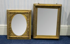 A Pair of Venetian Style Gilt Mirrors two in total, each in gilt swept/ornate frames,
