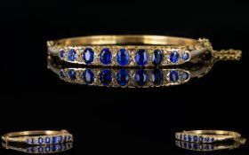 Antique Period Attractive and Pleasing 9ct Gold Sapphire and Diamond Hinged Bangle with attached