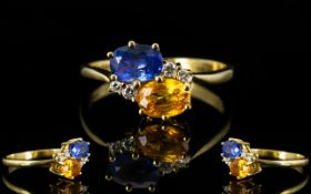 Ladies 18ct Gold Attractive Two Stone Sapphire and Diamond Dress Ring the blue sapphire and