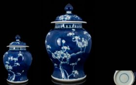A 20th Century Blue And White Ginger Jar With Cover Blue ground with prunus design, good condition,