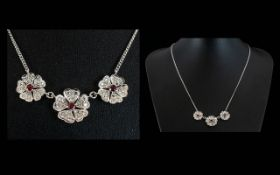 A Contemporary 18ct White Gold Ruby And Diamond Set Pendant Necklace Set with three flowerhead