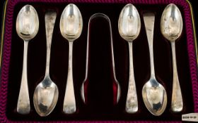 A Boxed Set of Six Silver Teaspoons with matching pair of Sugar Tongs. Hallmarked Sheffield 1930.