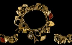 A Nice Quality 9ct Gold Curb Bracelet with Heart Shaped Padlock and Loaded with 24 Assorted 9ct