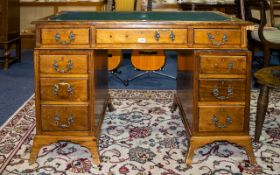 Twin Pedestal Writing Desk Comprising inset leather top, 3 frieze drawers, each pedestal with