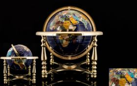World Globe Set With Lapis And Gemstones On brass lacquered stand with compass.