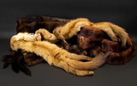 A Collection of Fur comprising two sets of mink stoles/tippets with head and tails and a dark brown