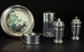 A Small Mixed Collection Of Hallmarked Silver Items To include a 1920's circular photo frame - oak