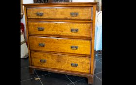Maple Front Chest Of Drawers Four long drawers with brass pull handles, raised on bracket feet,
