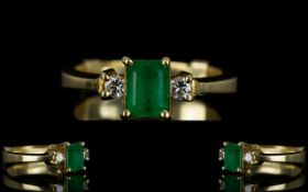 Ladies 18ct Gold Emerald and Diamond Dress Ring the central emerald of natural colour flanked by