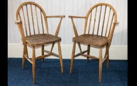 Ercol A Pair Of 1970's Elm/Ash Windsor Armchairs Each in good condition, impressed marks to back '