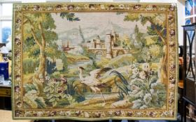 A Woven Tapestry Panel with floral and foliate borders and crane in landscape to centre.