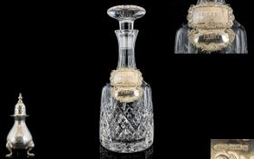 A Good Quality Lead Crystal Decanter with Attached Two Hallmarked Silver Spirit Labels,