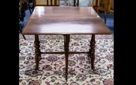 A Victorian Mahogany Sutherland Table of large proportions and typical form.
