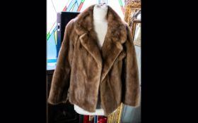 A Short Mink Evening Jacket Light golden brown hip length jacket with side seam pockets,