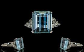 Platinum Set Aquamarine And Diamond Ring Set with a large faceted emerald cut aquamarine of