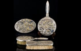 A Danish White Metal Vanity Set four items in total to include hand mirror, trinket box,