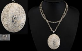 Contemporary and Impressive Large Oval Shaped Silver Hinged Locket with stylised decoration to