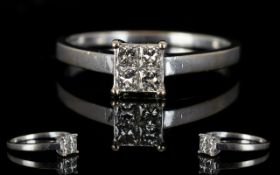 18ct White Gold Contemporary Diamond Set Dress Ring the four square cut diamonds of good colour and