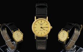 Longines Quartz Ladies Nice Quality 9ct Gold cased Wrist watch - with attached leather strap.