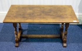An Oak Coffee Table By Bath Easton And Chingford Of typical rustic form with turned supports.