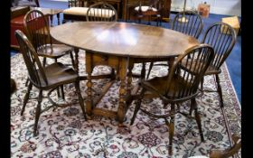 An Oak Drop Leaf Dining Table And Chairs By Bath Easton And Chingford Gate leg construction with