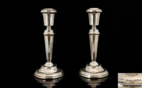 Elizabeth II Pair of Silver Candlesticks raised on a circular beaded stepped base.