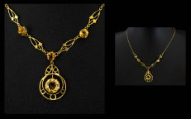 A 9ct Gold And Citrine Pendant Drop Necklace Lariat form necklace set with three faceted bright