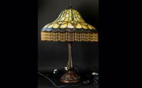 A Reproduction Tiffany Style Table Lamp Hexagonal cast metal base with opalescent geometric design