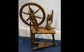 A Display Purposes Spinning Wheel Model of spinning wheel in varnished beech wood.