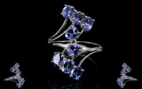 Tanzanite Crossover Ring, 3cts of oval c