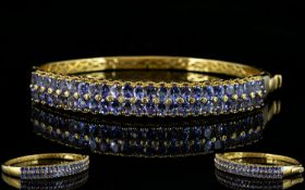 Tanzanite Double Row Hinged Bangle, two