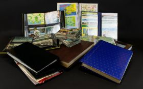 A Large Collection Of Postcards Comprisi
