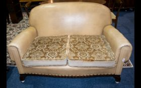 An Early 20th Century Two Seater Sofa art deco, tab sofa with x2 removable cushions.