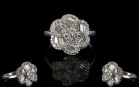 18ct White Gold Attractive and Stylish Baguette and Brilliant Cut Diamond Set Cluster Ring ' Swirl